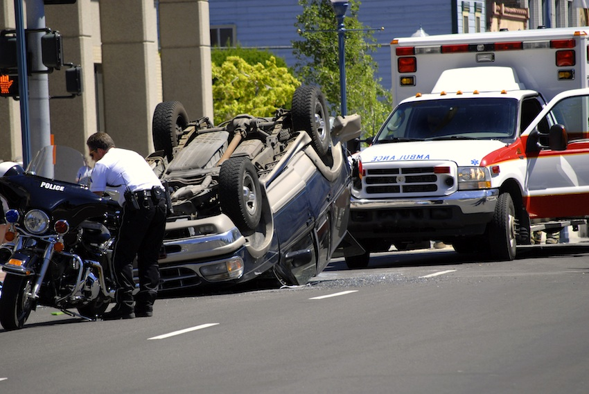 Car Wreck with Smashed Hood and Ambulance